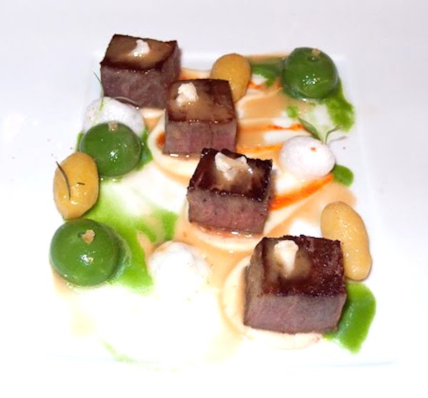 Cerdo ibérico con patatas salteadas y almejas
